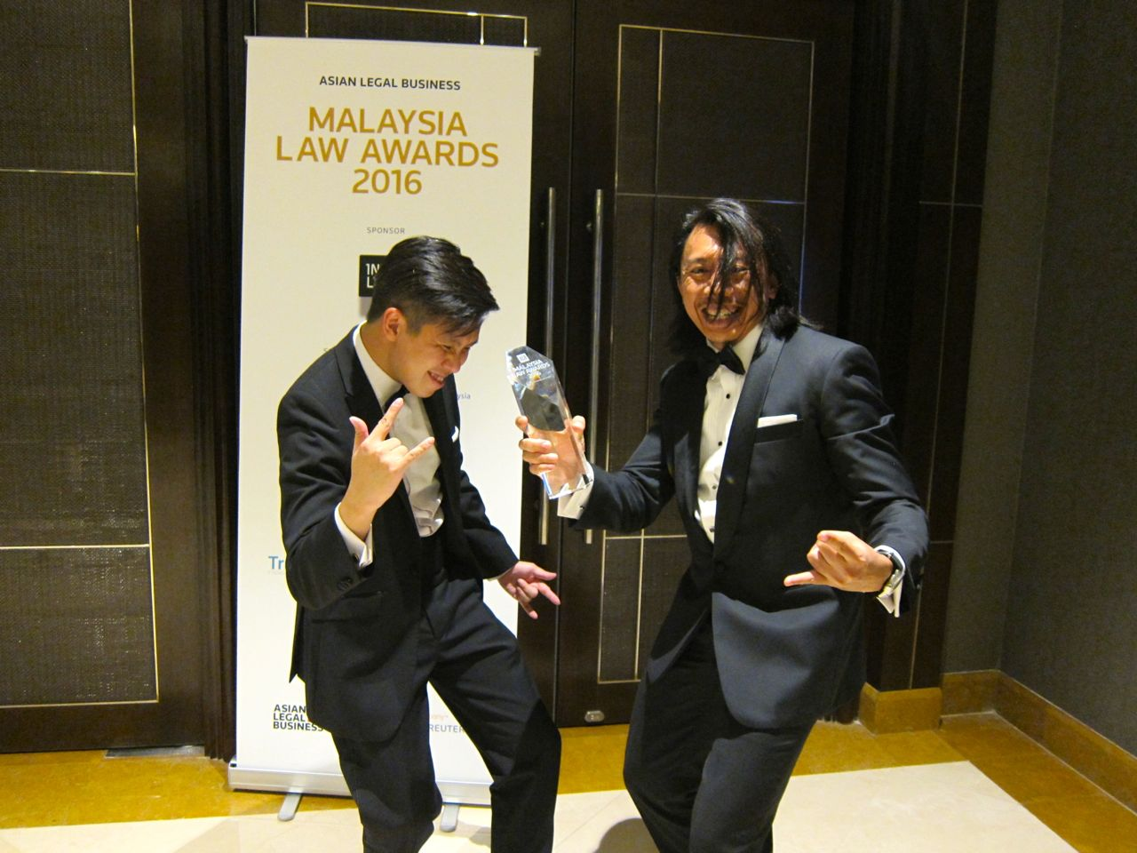 Sin Yew and Amer celebrating AmerBON's win as Litigation Law Firm of the Year