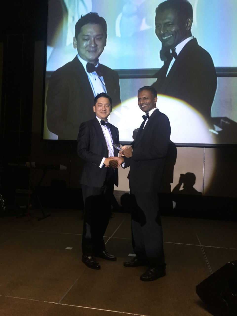 Marcus receiving the Rising Law Firm of the Year